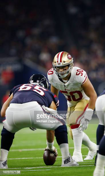 Brock Coyle of the San Francisco 49ers eyes the quarterback during the game against the Houston Texans at NRG Stadium on August 18, 2018 in Houston,...