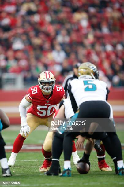 Brock Coyle of the San Francisco 49ers eyes the quarterback during the game against the Jacksonville Jaguars at Levi's Stadium on December 24, 2017...