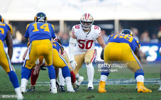Brock Coyle of the San Francisco 49ers eyes the quarterback during the game against the Los Angeles Rams at Los Angeles Memorial Coliseum on December...