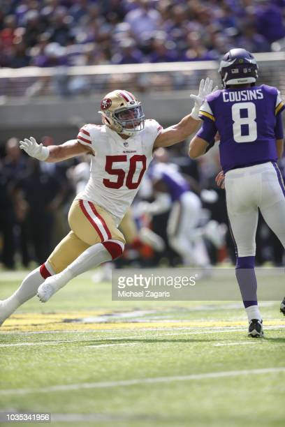 Brock Coyle of the San Francisco 49ers pressures Kirk Cousins of the Minnesota Vikings during the game at U.S. Bank Stadium on September 9, 2018 in...