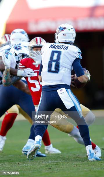 Brock Coyle of the San Francisco 49ers pressures Marcus Mariota of the Tennessee Titans during the game at Levi's Stadium on December 17, 2017 in...