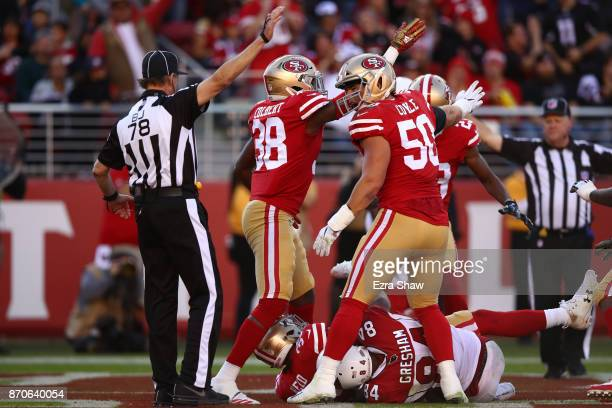 Brock Coyle of the San Francisco 49ers reacts after Eric Reid intercepted a pass intended for Jermaine Gresham of the Arizona Cardinals in the end...