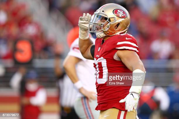 Brock Coyle of the San Francisco 49ers salutes after a play against the New York Giants during their NFL game at Levi's Stadium on November 12, 2017...