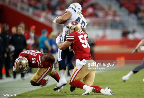 Brock Coyle of the San Francisco 49ers tackles Anthony Manzo-Lewis of the Los Angeles Chargers during the game at Levi Stadium on August 30, 2018 in...