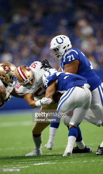 Brock Coyle of the San Francisco 49ers tackles Jordan Wilkins of the Indianapolis Colts during the game at Lucas Oil Stadium on August 25, 2018 in...