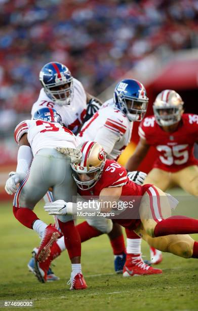 Brock Coyle of the San Francisco 49ers tackles Shane Vereen of the New York Giants during the game at Levi's Stadium on November 12, 2017 in Santa...