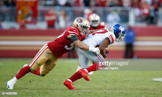 Brock Coyle of the San Francisco 49ers tackles Sterling Shepard of the New York Giants during the game at Levi's Stadium on November 12, 2017 in...