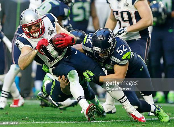 Brock Coyle of the Seattle Seahawks tackles Julian Edelman of the New England Patriots during Super Bowl XLIX at University of Phoenix Stadium on...