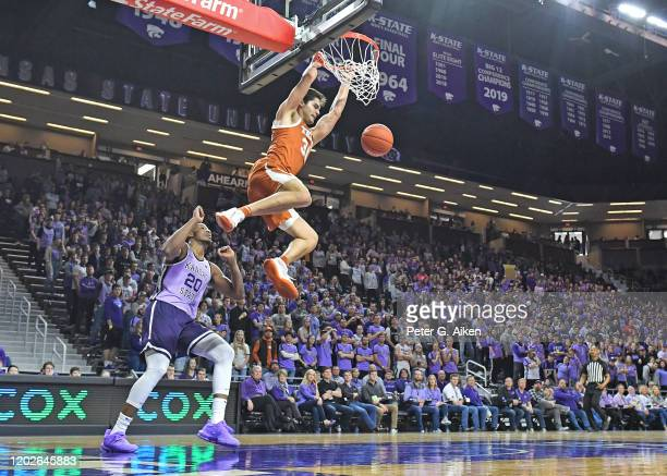 Brock Cunningham of the Texas Longhorns dunks over Xavier Sneed of the Kansas State Wildcats during the first half at Bramlage Coliseum on February...