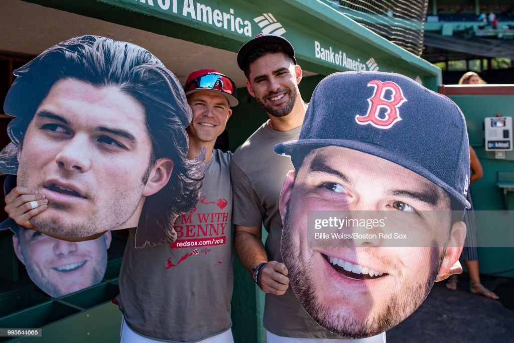 Brock Holt #12 and J.D. Martinez #28 of the Boston Red Sox pose for a photograph with big head cutouts of Andrew Benintendi #16 before a game against the Texas Rangers on July 10, 2018 at Fenway Park in Boston, Massachusetts.