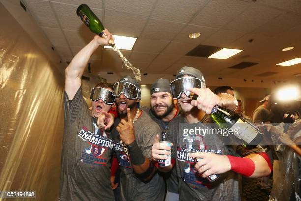 Brock Holt Eduardo Nunez Mitch Moreland and Andrew Benintendi of the Boston Red Sox celebrate in the clubhouse after defeating the Houston Astros 41...