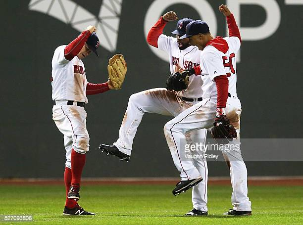 Brock Holt Jackie Bradley Jr #25 and Mookie Betts of the Boston Red Sox celebrate after a victory over the New York Yankees at Fenway Park on May 1...