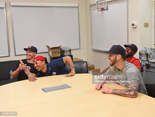 Brock Holt Mookie Betts Jackie Bradley Jr #25 and Blake Swihart laugh during a break in filming a commercial on July 8 2016 at Fenway Park in Boston...