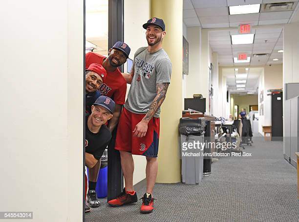 Brock Holt Mookie Betts Jackie Bradley Jr #25 and Blake Swihart of the Boston Red Sox glance out of a conference room while filming a commercial...