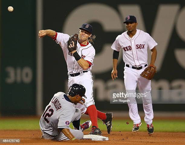 Brock Holt of the Boston Red Sox attempts a double play as Francisco Lindor of the Cleveland Indians slides late in to second base in the fourth...
