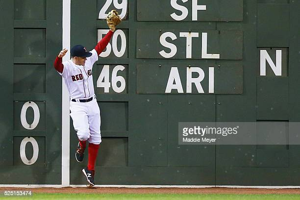 Brock Holt of the Boston Red Sox catches a ball hit by Kelly Johnson of the Atlanta Braves during the sixth inning on April 27 2016 in Boston...
