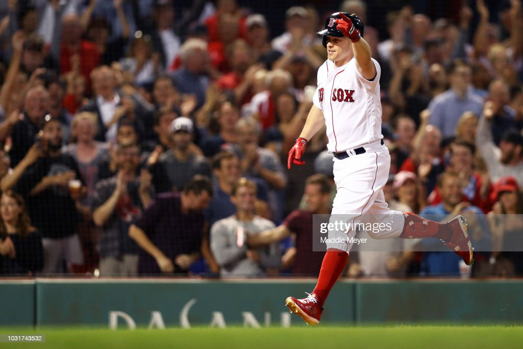 Brock Holt #12 of the Boston Red Sox celebrates after hitting a three run home run against the Toronto Blue Jays during the seventh inning at Fenway Park on September 11, 2018 in Boston, Massachusetts.