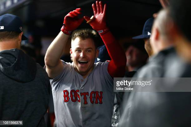 Brock Holt of the Boston Red Sox celebrates after hitting a two run home run against Austin Romine of the New York Yankees during the ninth inning in...