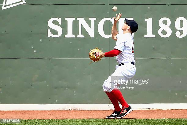 Brock Holt of the Boston Red Sox collects a ball off the Green Monster hit by Jose Altuve of the Houston Astros during the first inning on May 14...