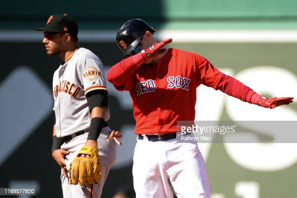 Brock Holt of the Boston Red Sox dabs after hitting a double in the fifth inning against the San Francisco Giants at Fenway Park on September 19 2019...