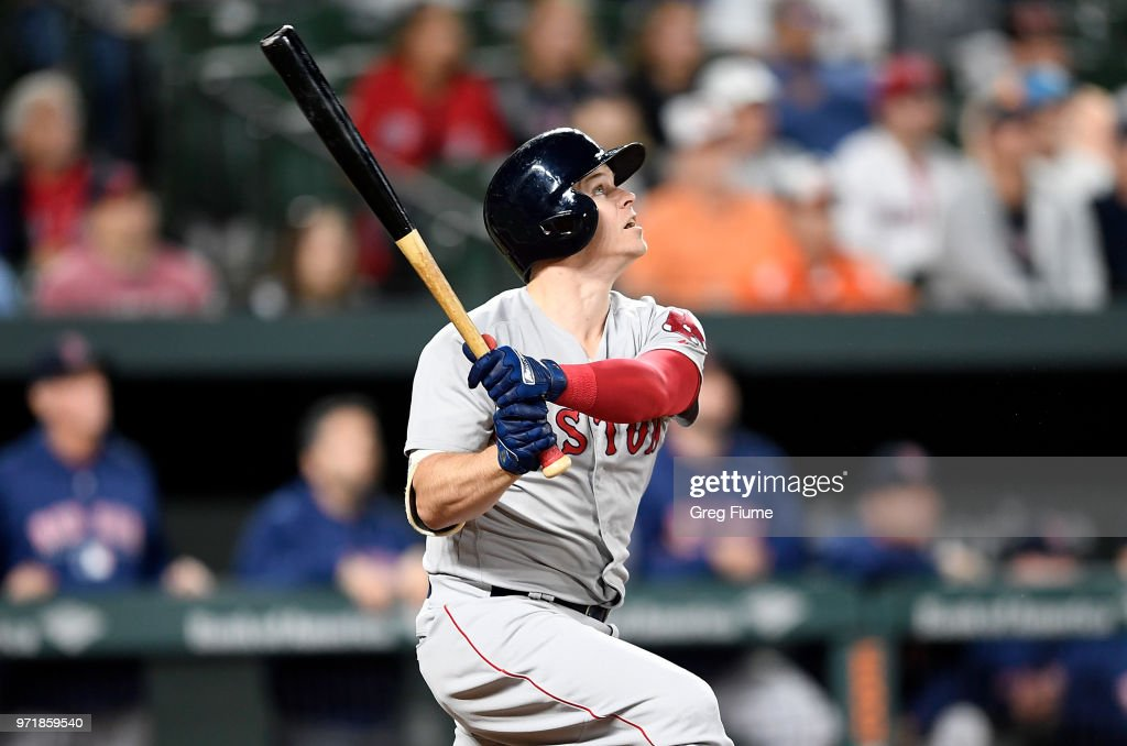 Brock Holt #12 of the Boston Red Sox drives in the game winning run with a sacrifice fly in the 12th inning against the Baltimore Orioles at Oriole Park at Camden Yards on June 11, 2018 in Baltimore, Maryland. Boston won the game 2-0.