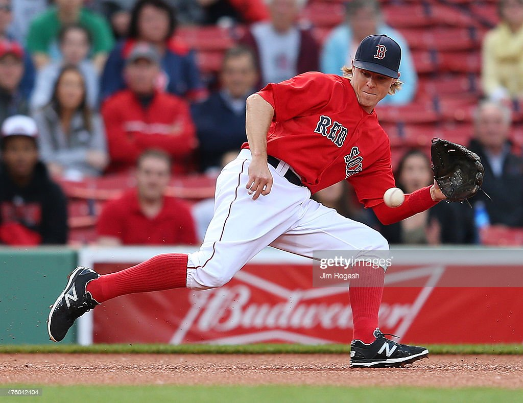 Brock Holt #26 of the Boston Red Sox fields a ball hit by Ben Zobrist #18 of the Oakland Athletics in the first inning against the Oakland Athletics inning at Fenway Park on June 5, 2015 in Boston, Massachusetts.