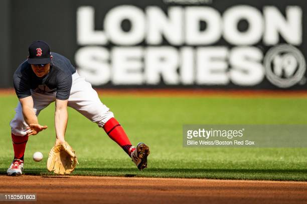 Brock Holt of the Boston Red Sox fields a ground ball during a team workout ahead of the 2019 Major League Baseball London Series on June 28 2019 at...