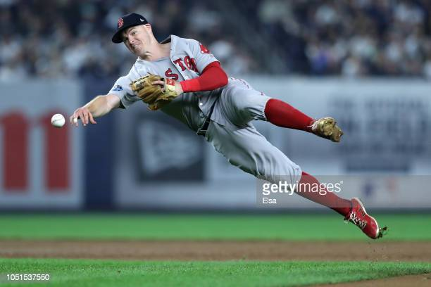 Brock Holt of the Boston Red Sox fields a hit by Luke Voit of the New York Yankees during the fourth inning in Game Three of the American League...