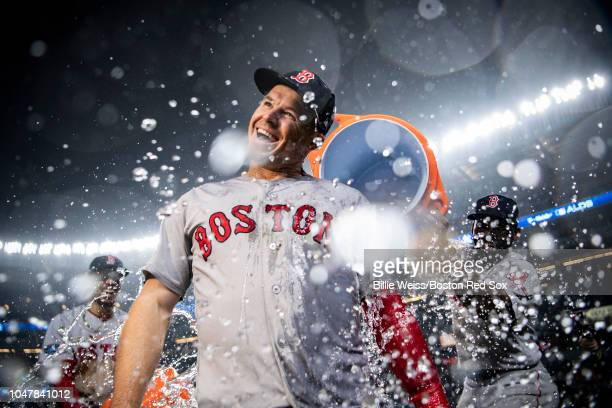 Brock Holt of the Boston Red Sox is doused with Gatorade after hitting for the cycle after game three of the American League Division Series against...