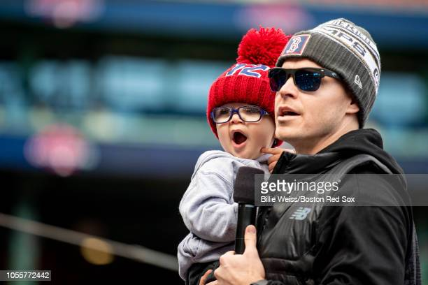 Brock Holt of the Boston Red Sox is introduced with his son Griff during the 2018 World Series rolling rally parade on October 31 2018 in Boston...