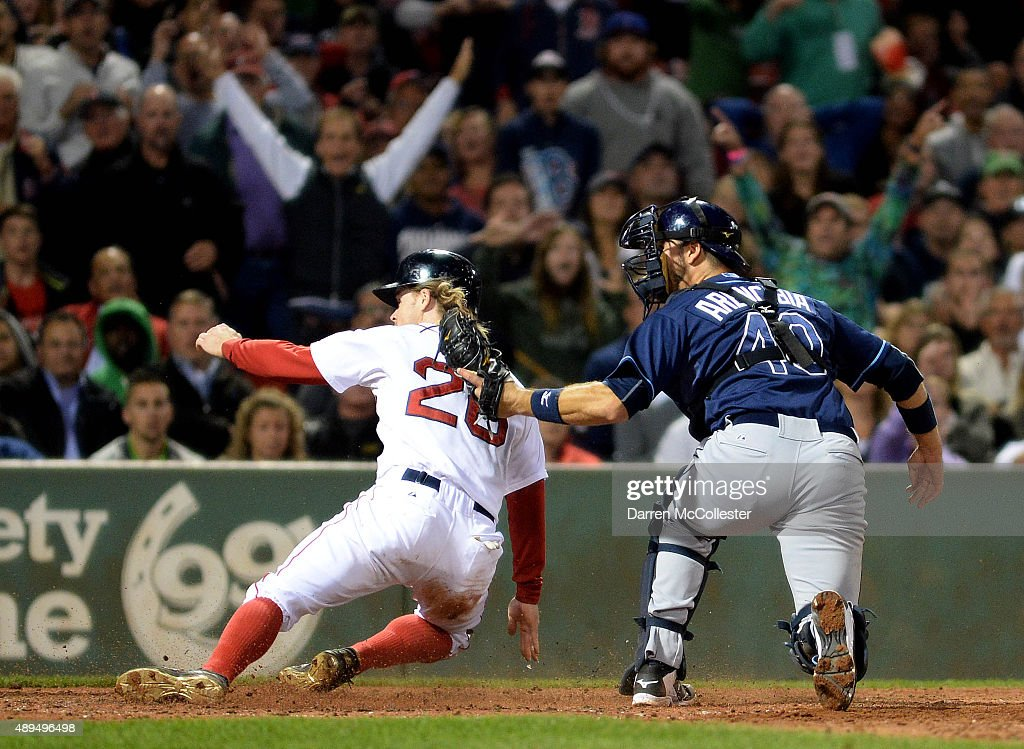 Brock Holt #26 of the Boston Red Sox is tagged out at home base by J.P Arencibia #40 of the Tampa Bay Rays in the sixth inning at Fenway Park on September 21, 2015 in Boston, Massachusetts.