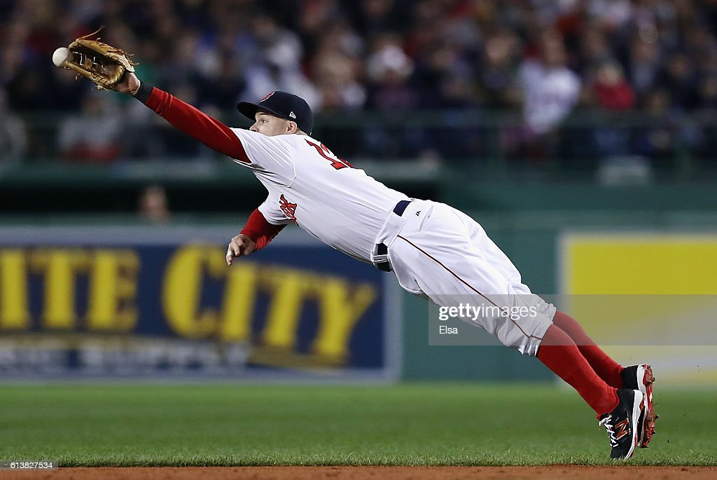 Brock Holt #12 of the Boston Red Sox is unable to catch a ball hit by Lonnie Chisenhall #8 of the Cleveland Indians (not pictured) in the second inning during game three of the American League Divison Series at Fenway Park on October 10, 2016 in Boston, Massachusetts.