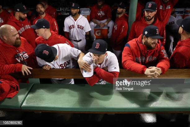 Brock Holt of the Boston Red Sox looks on from the dugout prior to Game 1 of the 2018 World Series against the Los Angeles Dodgers at Fenway Park on...