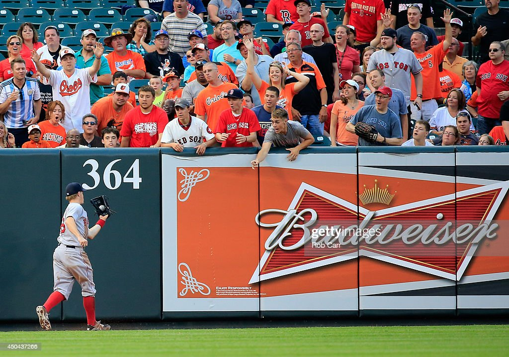 Brock Holt #26 of the Boston Red Sox makes a catch in the outfield against the Baltimore Orioles at Oriole Park at Camden Yards on June 9, 2014 in Baltimore, Maryland.