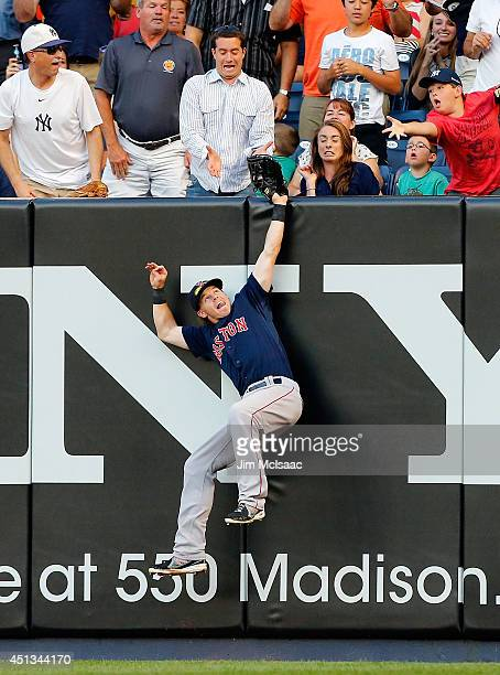 Brock Holt of the Boston Red Sox makes a catch on a ball hit in the second inning by Brian Roberts of the New York Yankees at Yankee Stadium on June...