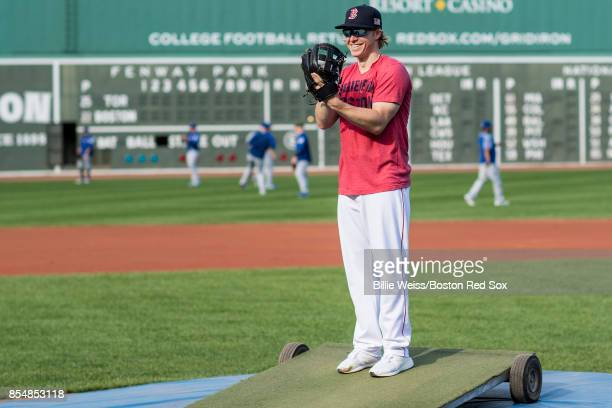 Brock Holt of the Boston Red Sox pretends to pitch before a game against the Toronto Blue Jays on September 27 2017 at Fenway Park in Boston...