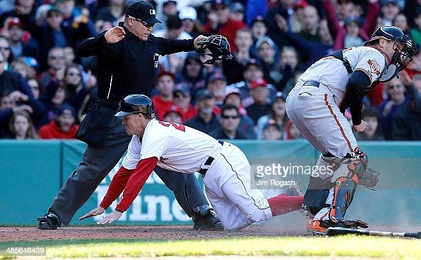 Brock Holt of the Boston Red Sox reacts after he scored on a suicide squeeze against the Baltimore Orioles in the seventh inning at Fenway Park on...