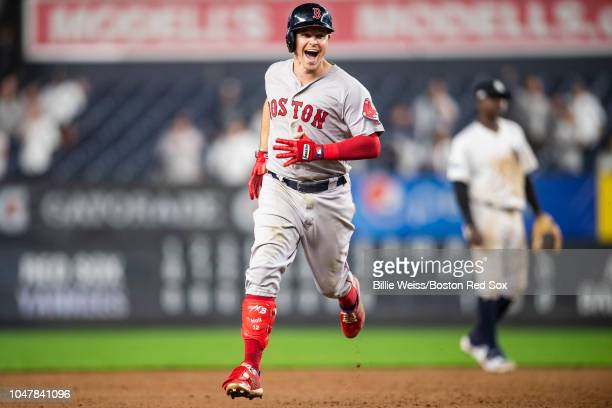 Brock Holt of the Boston Red Sox reacts after hitting a home run during the inning of game three of the American League Division Series to hit for...