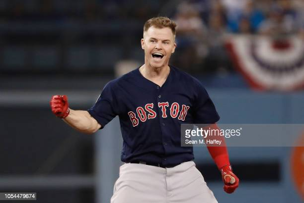 Brock Holt of the Boston Red Sox reacts at second base after hitting a oneout double to left field in the ninth inning of Game Four of the 2018 World...