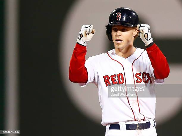 Brock Holt of the Boston Red Sox reacts at second base following his tworun double in the sixth inning against the Cleveland Indians during the game...
