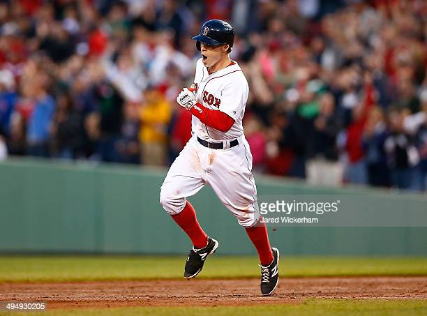 Brock Holt of the Boston Red Sox reacts while rounding second base in the third inning after hitting a tworun home run against the Tampa Bay Rays...