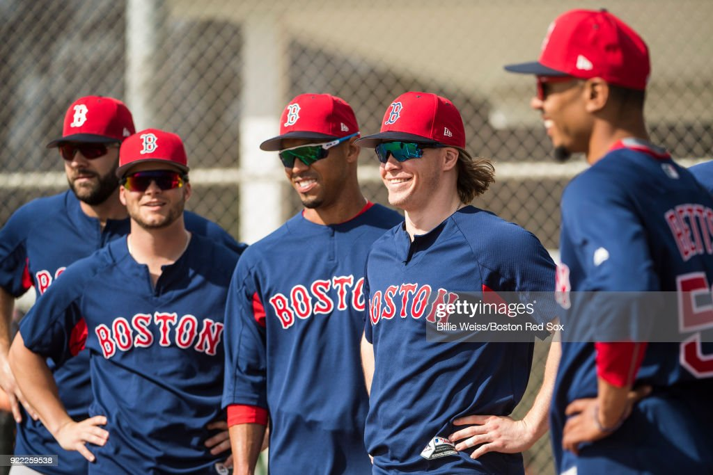 Brock Holt #12 of the Boston Red Sox reacts with teammates during a team workout on February 21, 2018 at jetBlue Park at Fenway South in Fort Myers, Florida .