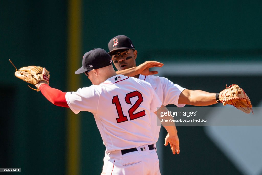 Brock Holt #12 of the Boston Red Sox reacts with Xander Bogaerts after a victory against the Toronto Blue Jays on May 30, 2018 at Fenway Park in Boston, Massachusetts.