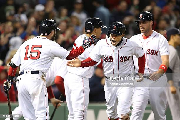 Brock Holt of the Boston Red Sox returns to the dugout after scoring in the seventh inning in the game against the New York Yankees at Fenway Park on...