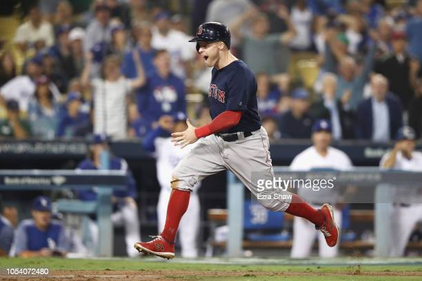Brock Holt of the Boston Red Sox scores a thirteenth inning run against the Los Angeles Dodgers in Game Three of the 2018 World Series at Dodger...