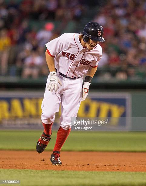 Brock Holt of the Boston Red Sox screams after hurting his leg while rounding first base against the Detroit Tigers during the first inning at Fenway...