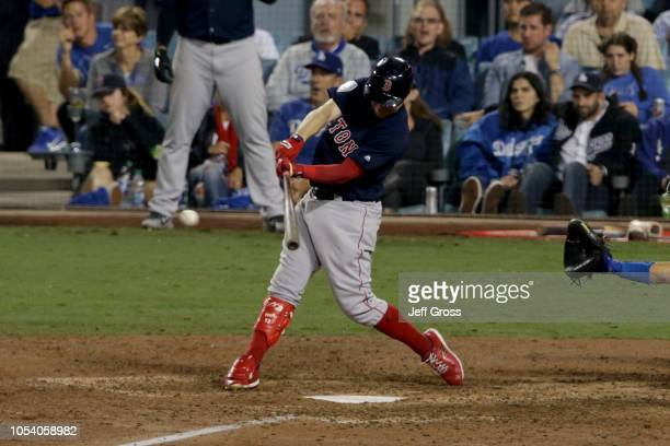 Brock Holt of the Boston Red Sox singles during the tenth inning against the Los Angeles Dodgers in Game Three of the 2018 World Series at Dodger...