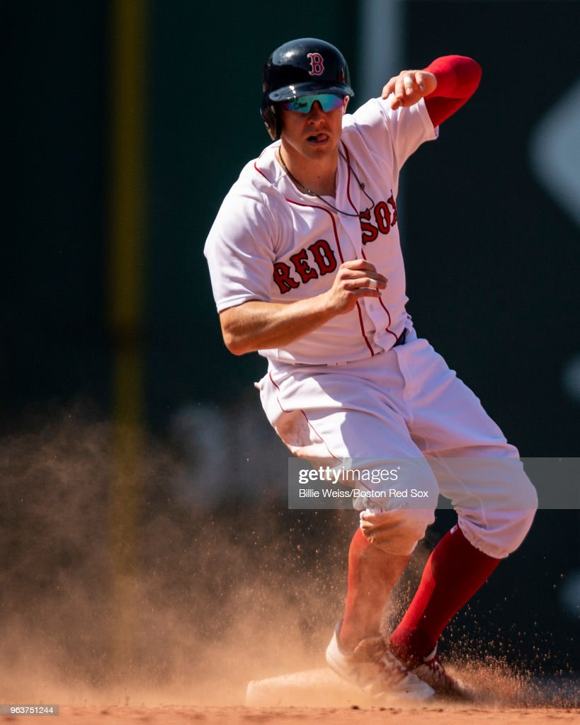 Brock Holt #12 of the Boston Red Sox slides as he steals second base during the eighth inning of a game against the Toronto Blue Jays on May 30, 2018 at Fenway Park in Boston, Massachusetts.