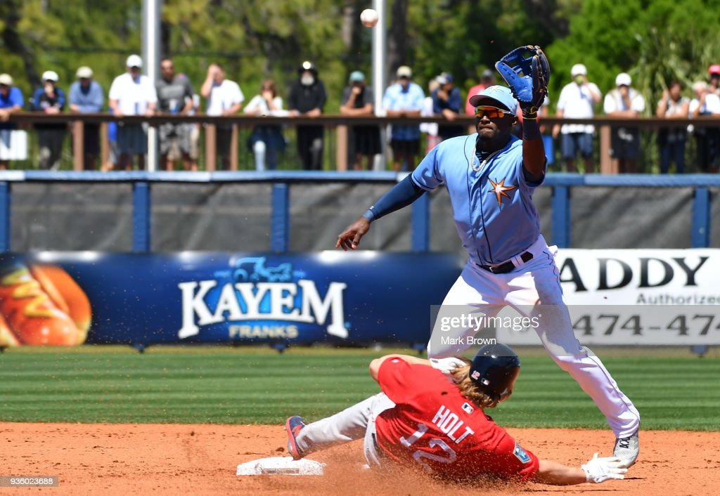Brock Holt #12 of the Boston Red Sox slides into second base in the fourth inning during the spring training game between the Tampa Bay Rays and the Boston Red Sox at Charlotte Sports Park on March 21, 2018 in Port Charlotte, Florida.