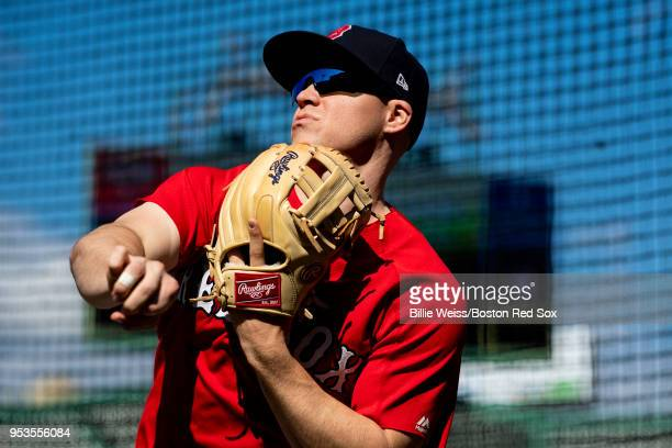 Brock Holt of the Boston Red Sox throws before a game against the Kansas City Royals on May 1 2018 at Fenway Park in Boston Massachusetts